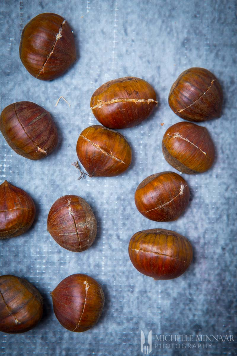 What Kind Of Nut Has A Hole >> Roasted Chestnuts Learn How To Prepare One Of Winter S Simple