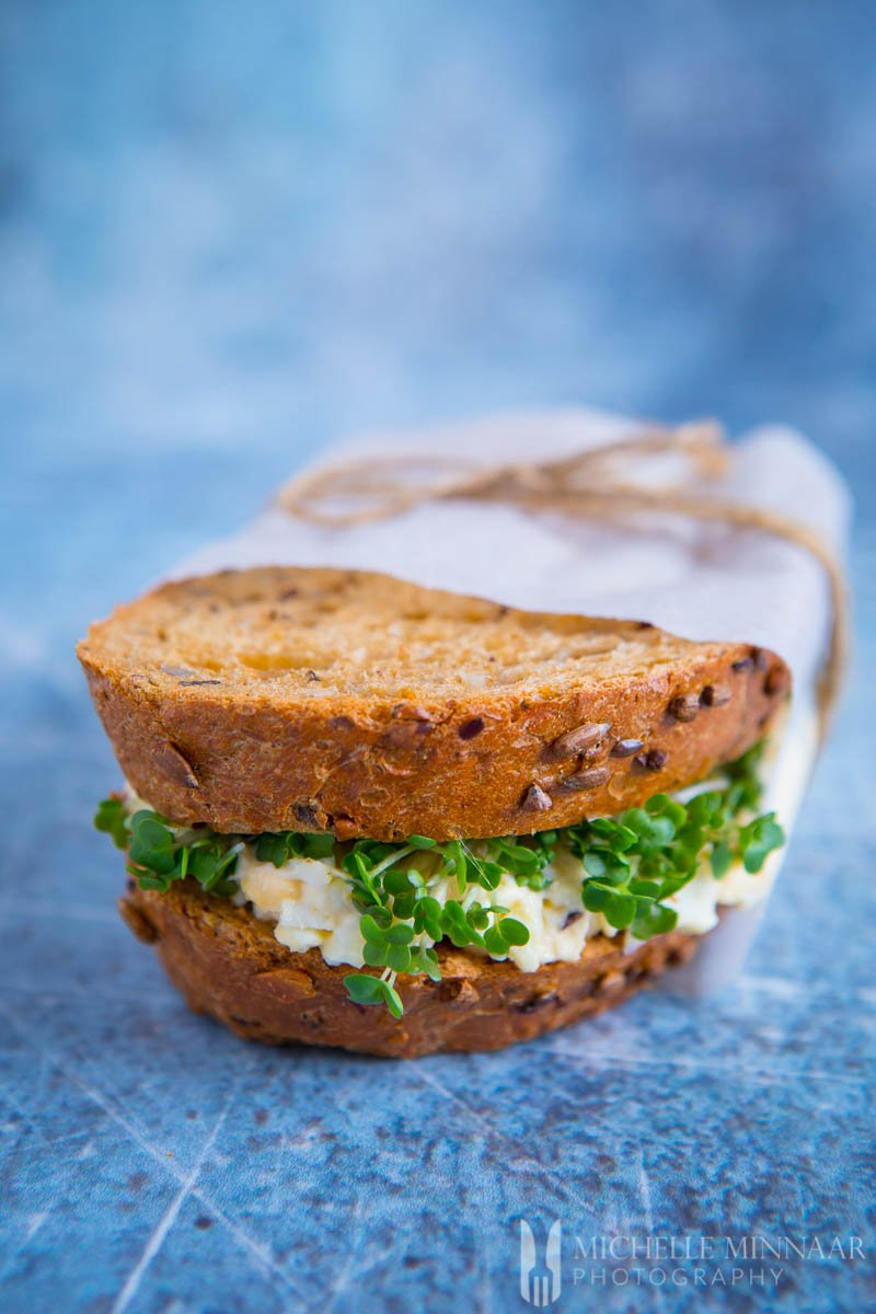 egg and cress sandwich, brown bread with egg and watercress