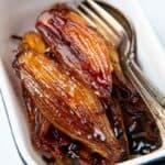 Casserole dish of glazed shallots