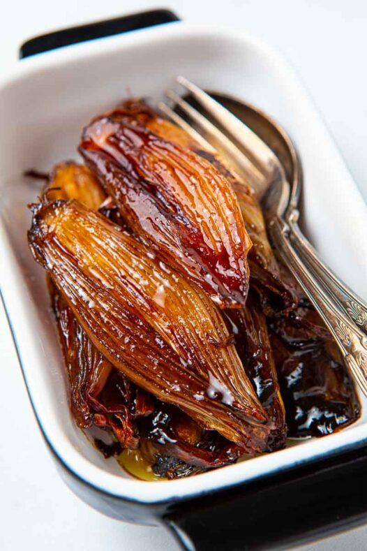 Casserole dish of glazed shallots