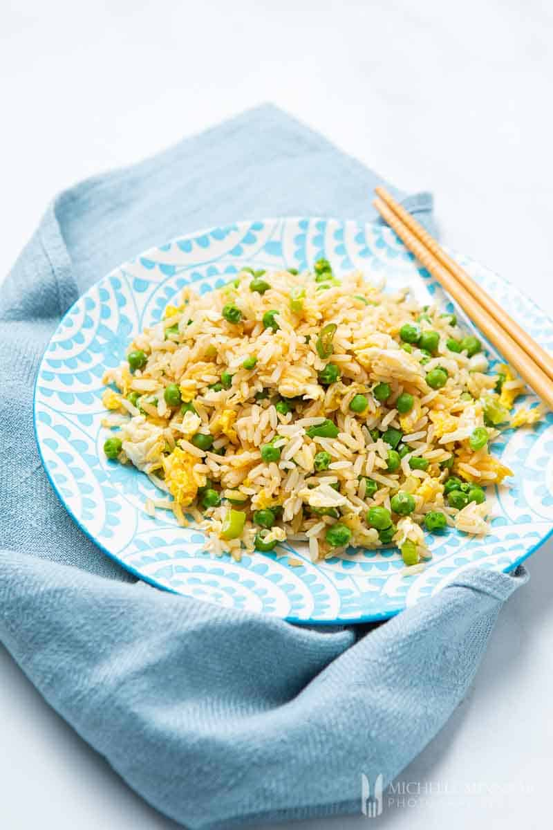 Plate of slimming world egg fried rice and chop sticks