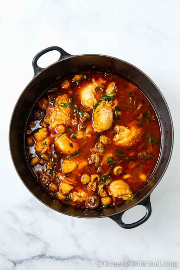 Chicken cooking in a saucepan