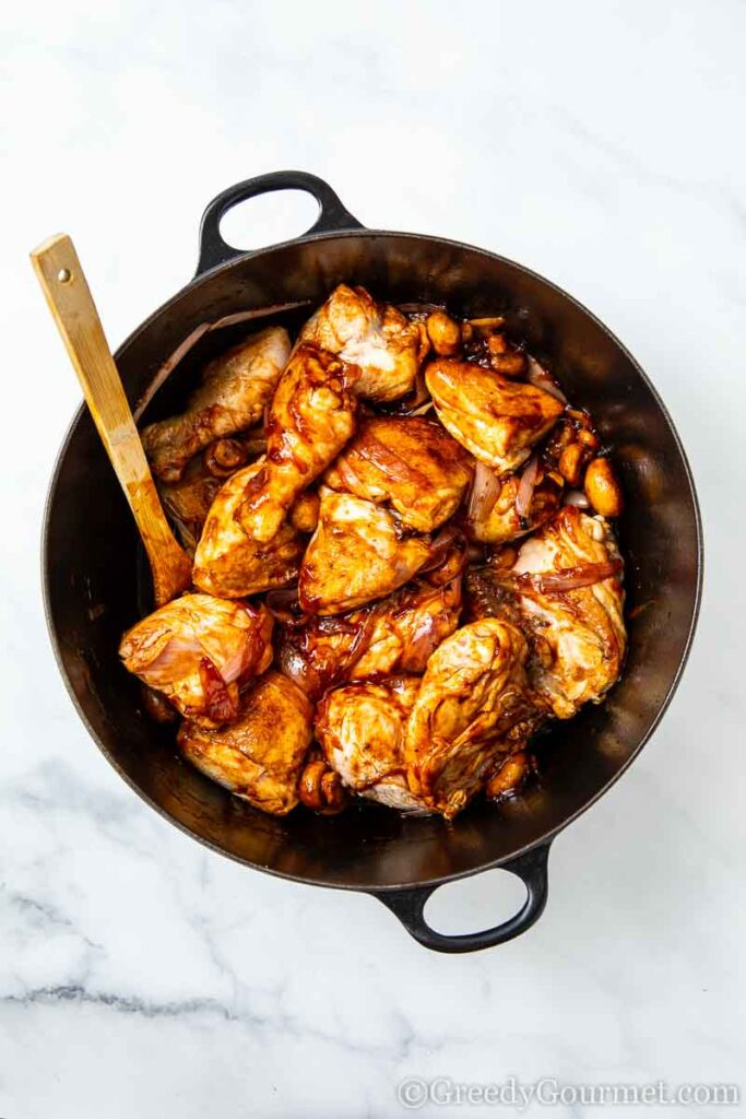 Chicken smothered in sauce to make a French chicken recipe