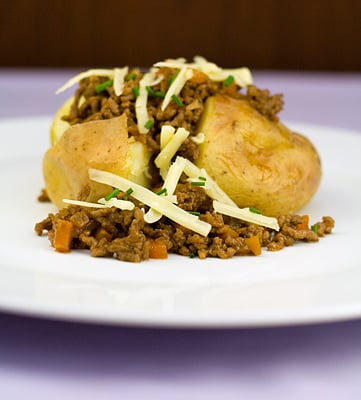 Baked Jacket Potatoes topped with Flavoured Beef Mince & Cheese