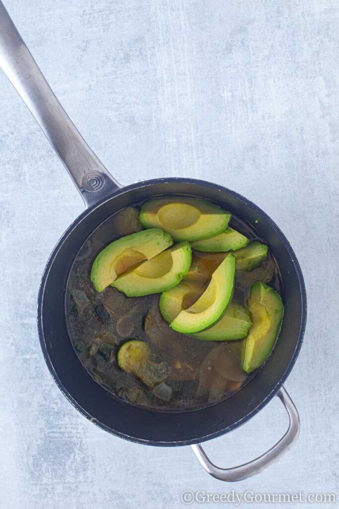 Avocados in a pan to make a vegan avocado soup,