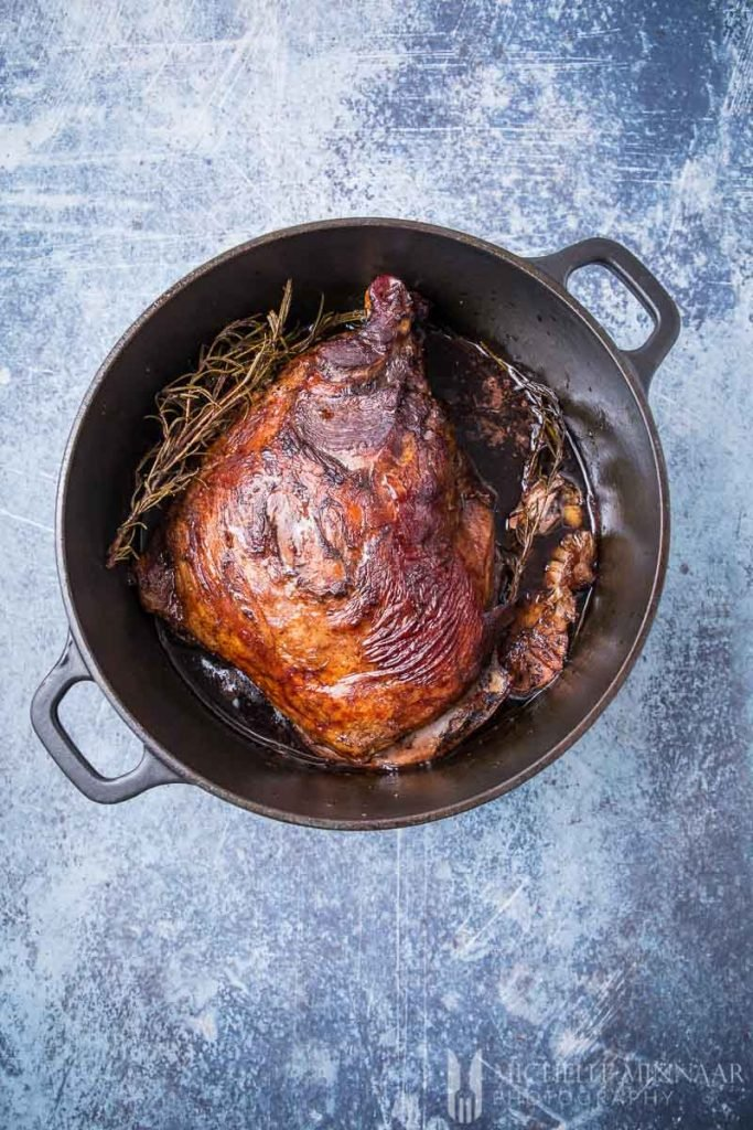 Lamb cooked in a pot with rosemary
