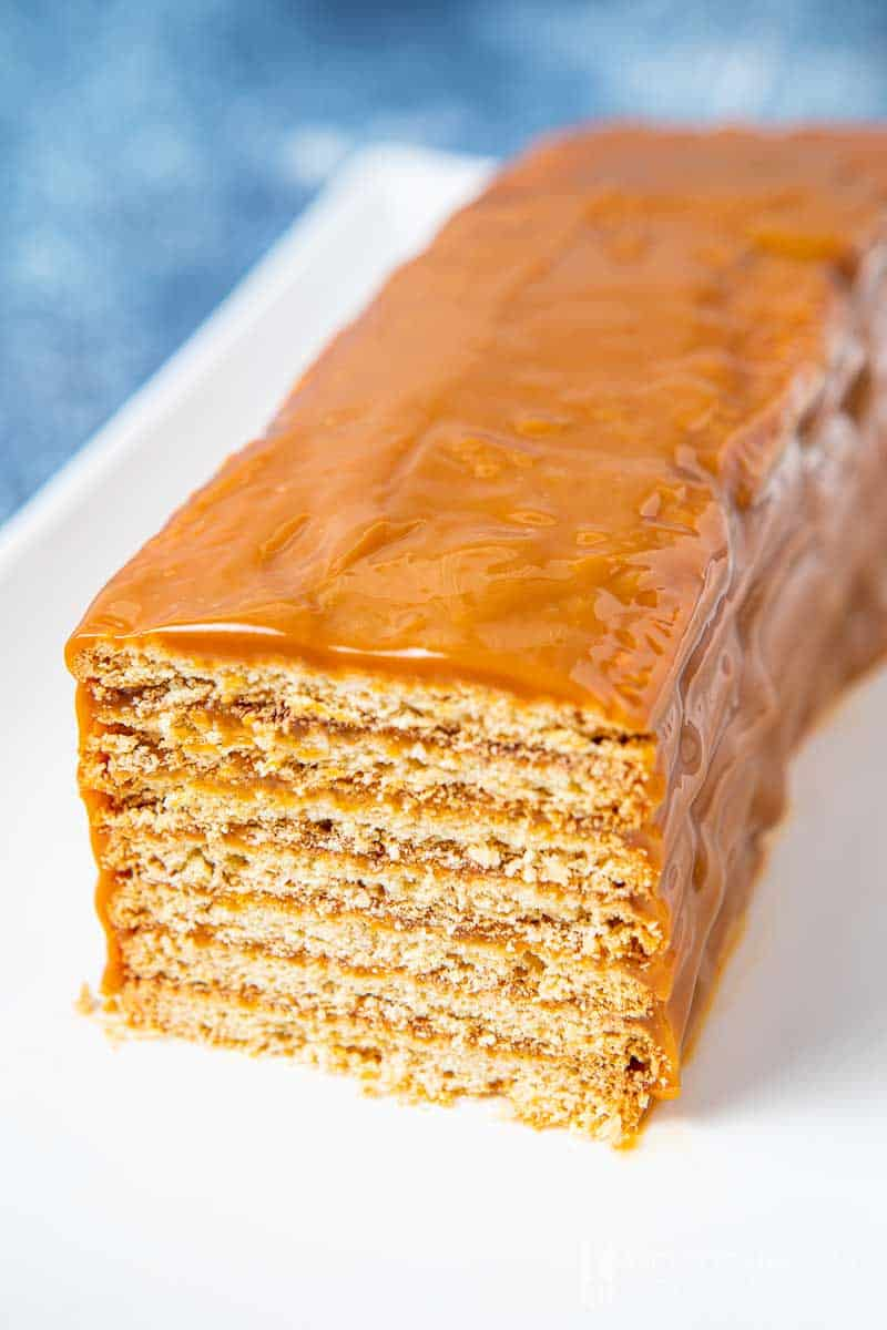 Layered cookies covered in caramel sauce