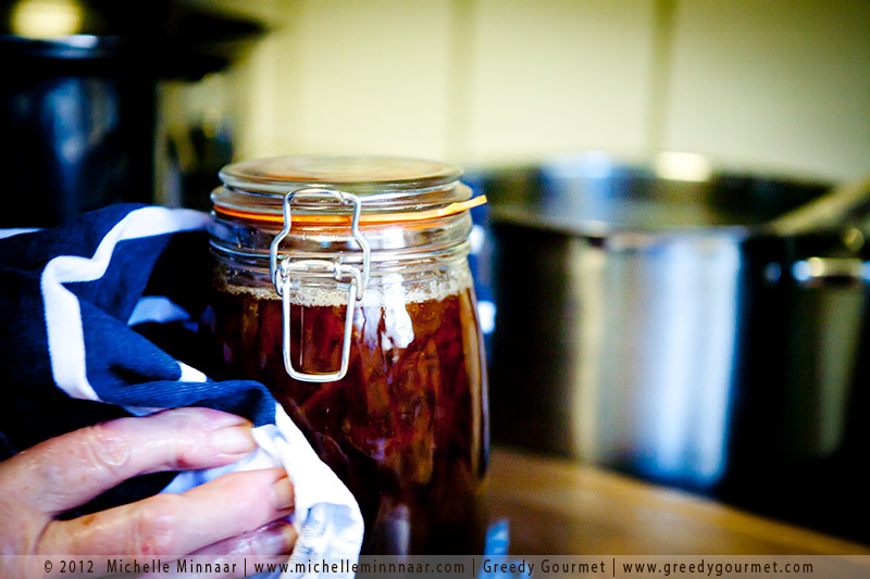 Giving marmalade jars a wipe