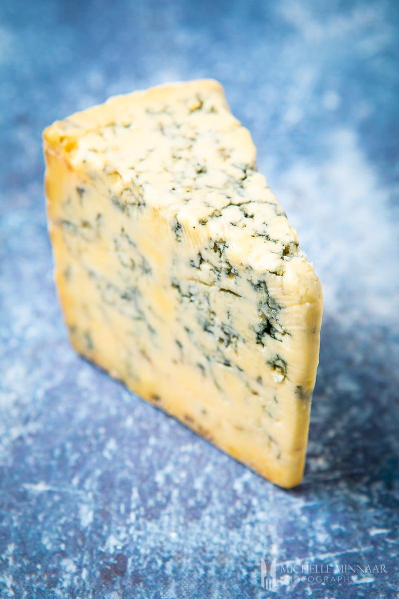 A large block of blue cheese