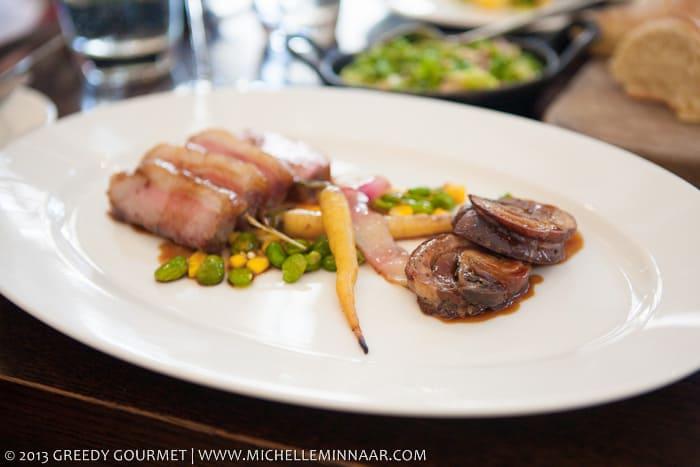 Roast loin and braised breast of lamb, Heritage carrots, roast corn, broad beans, confit garlic jus