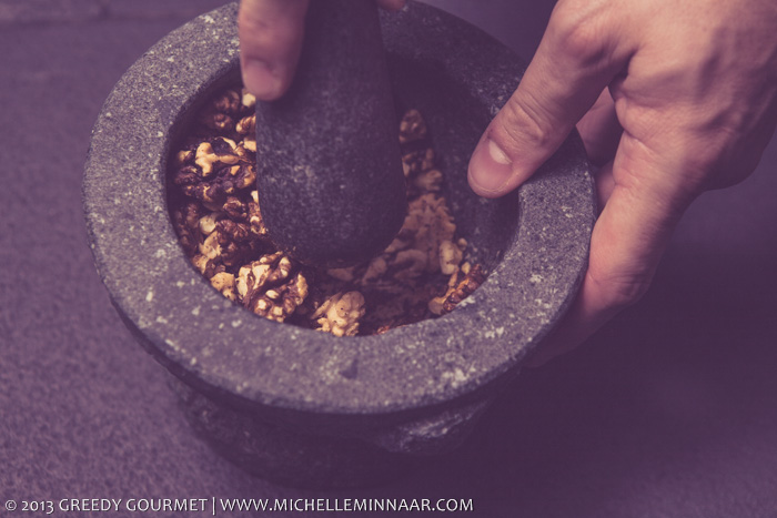 Crushing Walnuts With Pestle
