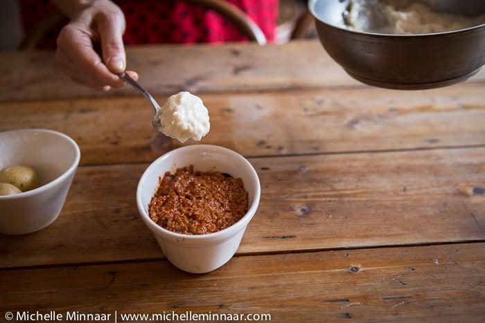 Adding béchamel sauce layer