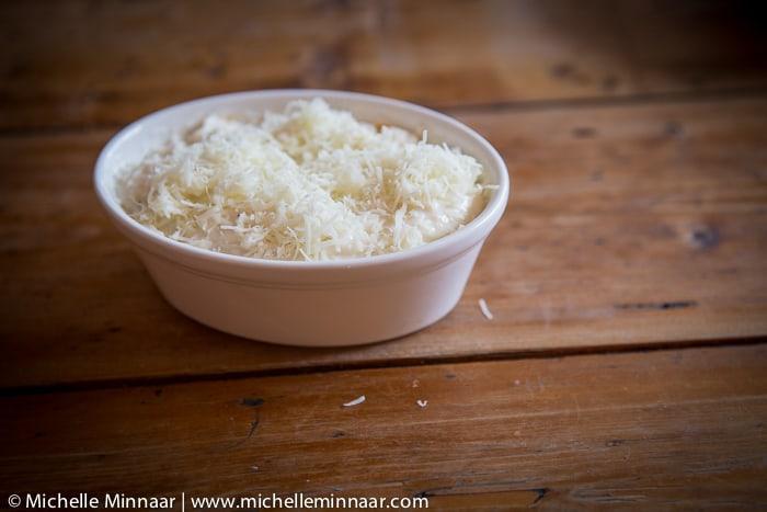 Grated kassari cheese on top of moussaka