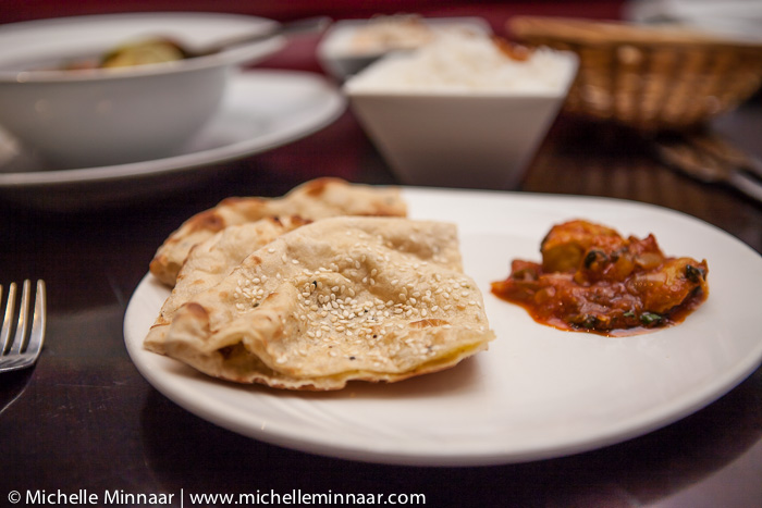 Naan and curry on a plate