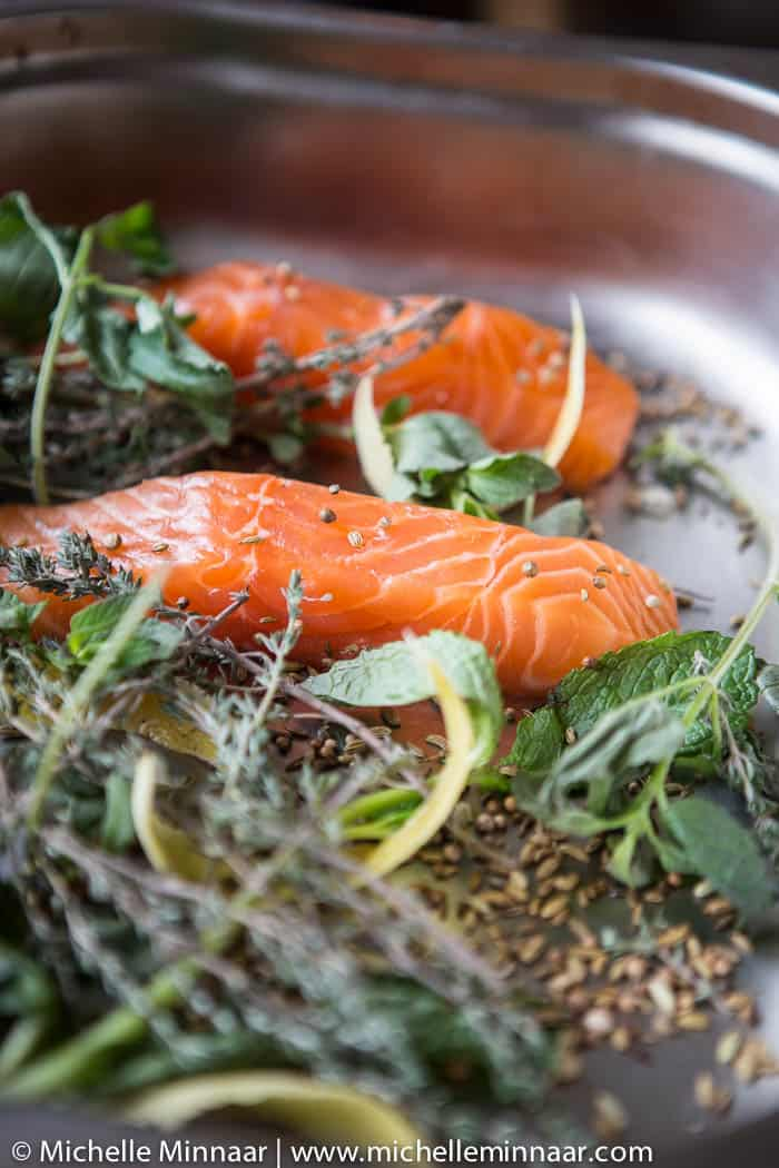 Raw salmon fillet with herbs