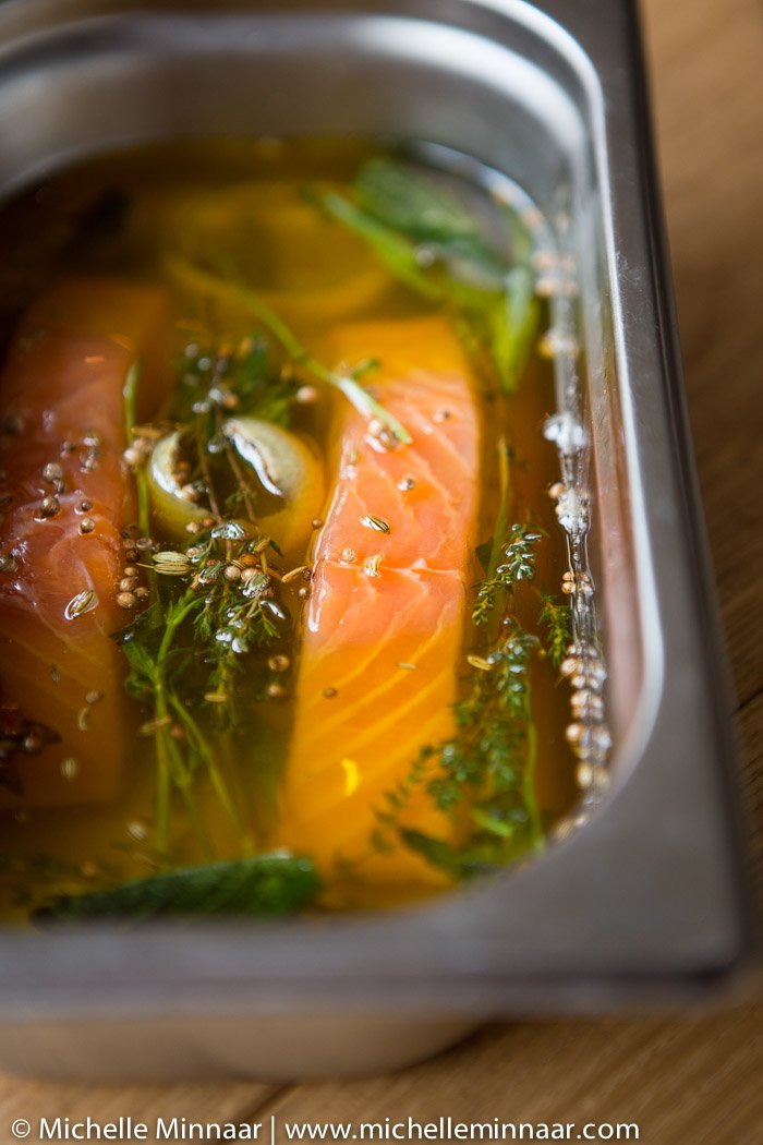 Salmon submerged in clarified butter