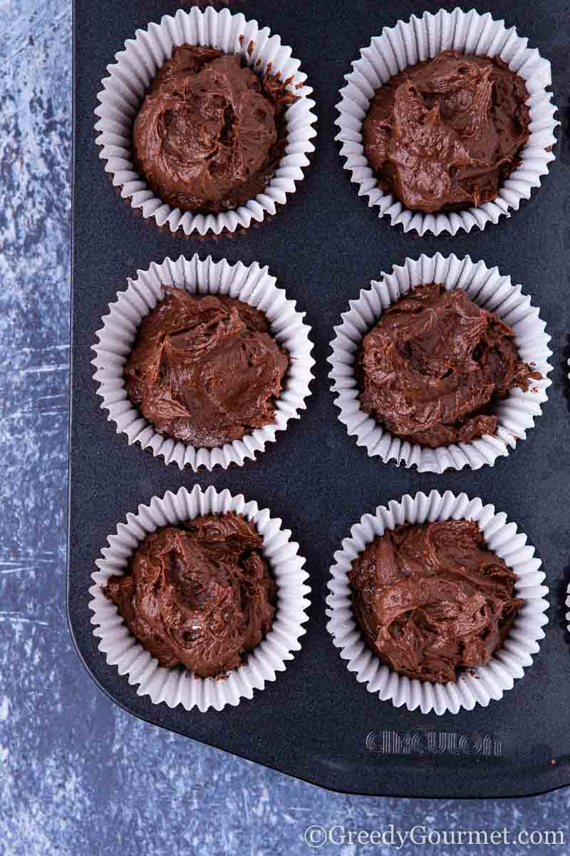 Cupcake tins filled with chocolate batter
