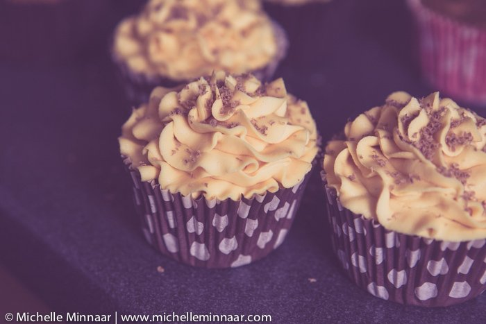 Decorate cupcakes with grated chocolate