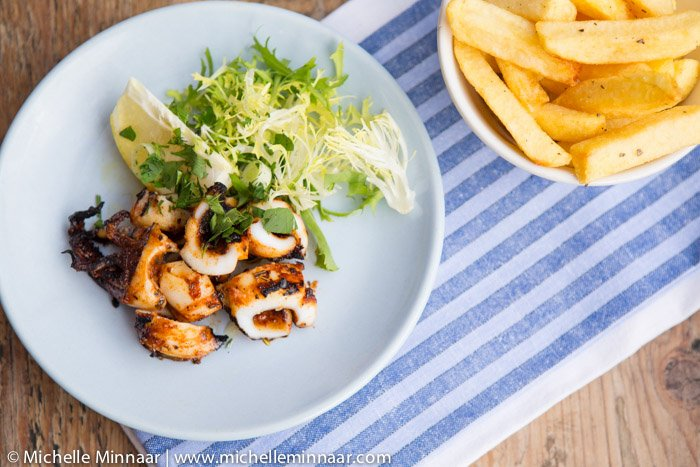 A plate of grilled calamari and fries