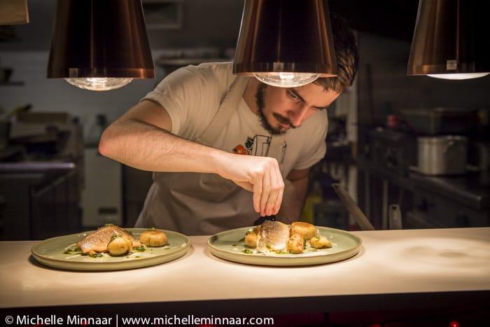 Chef garnishing food