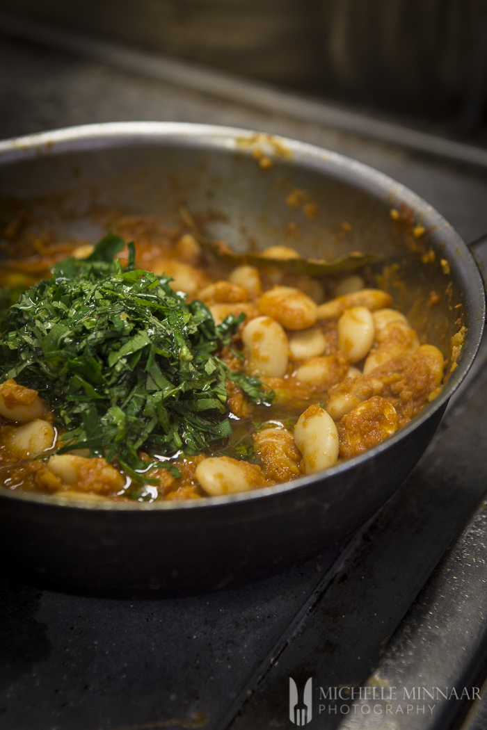 Parsley topped butter beans