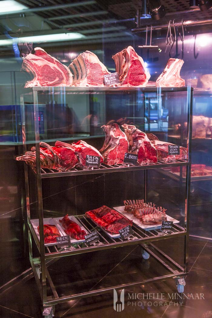 Racks of raw 28 days matured meat in a meat locker