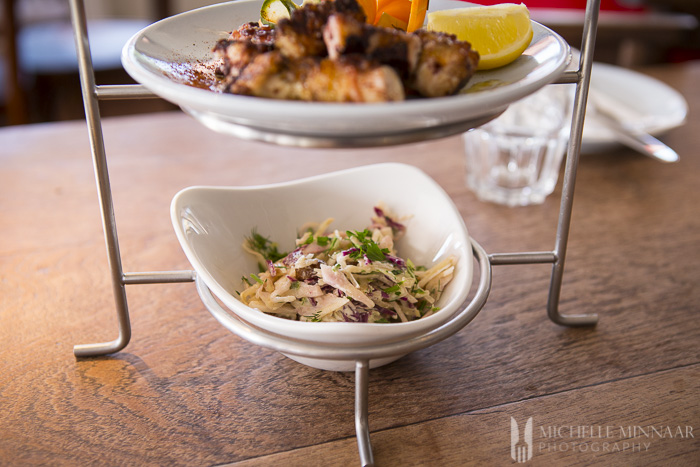Thinly shredded red and white cabbage, mixed with sultanas, lemon mayonnaise and fresh dill