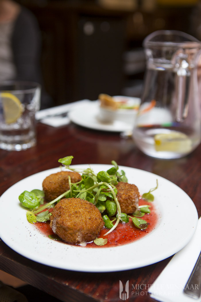 Crumbed Camembert with pea shoots