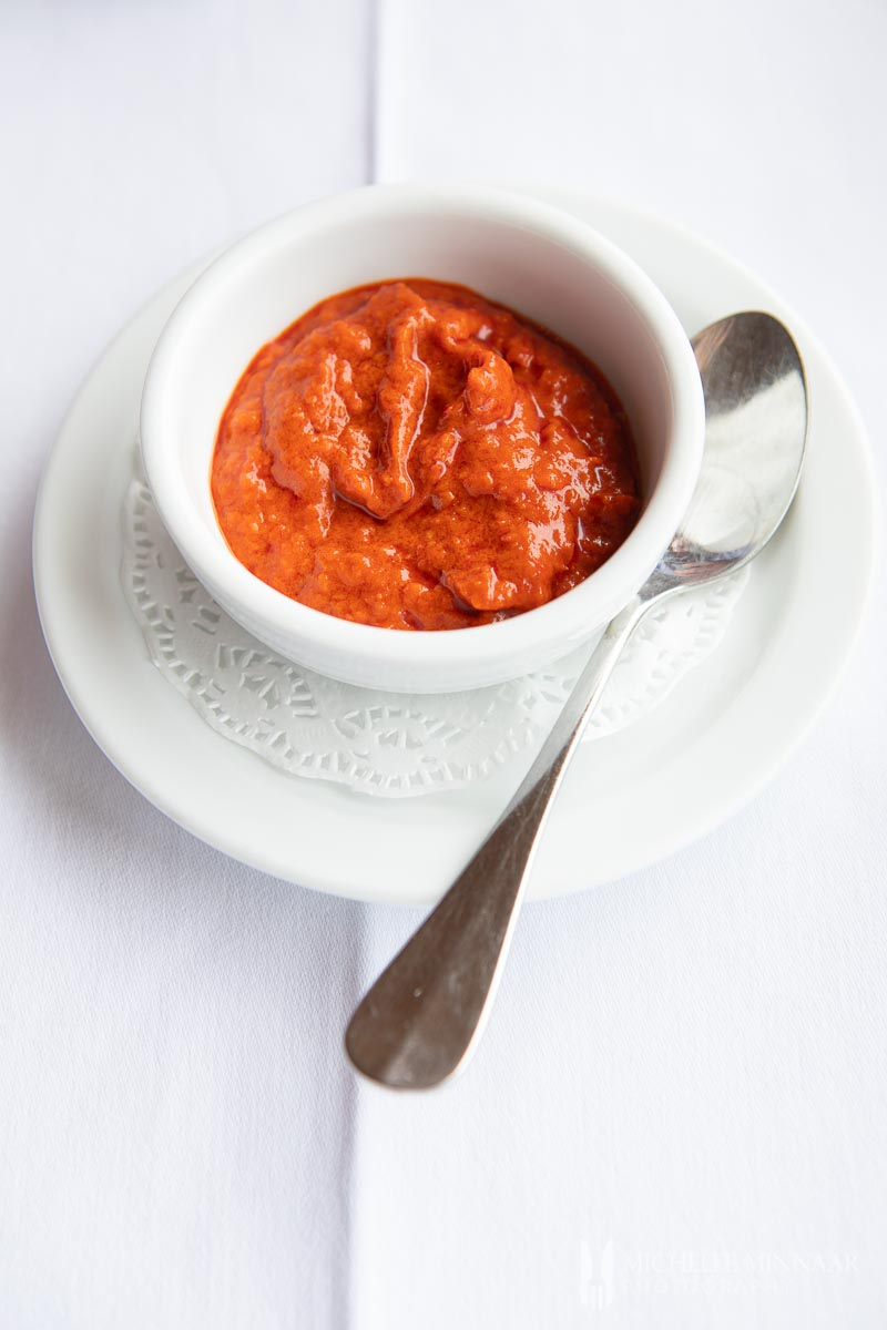 A close up of a red tomato sauce