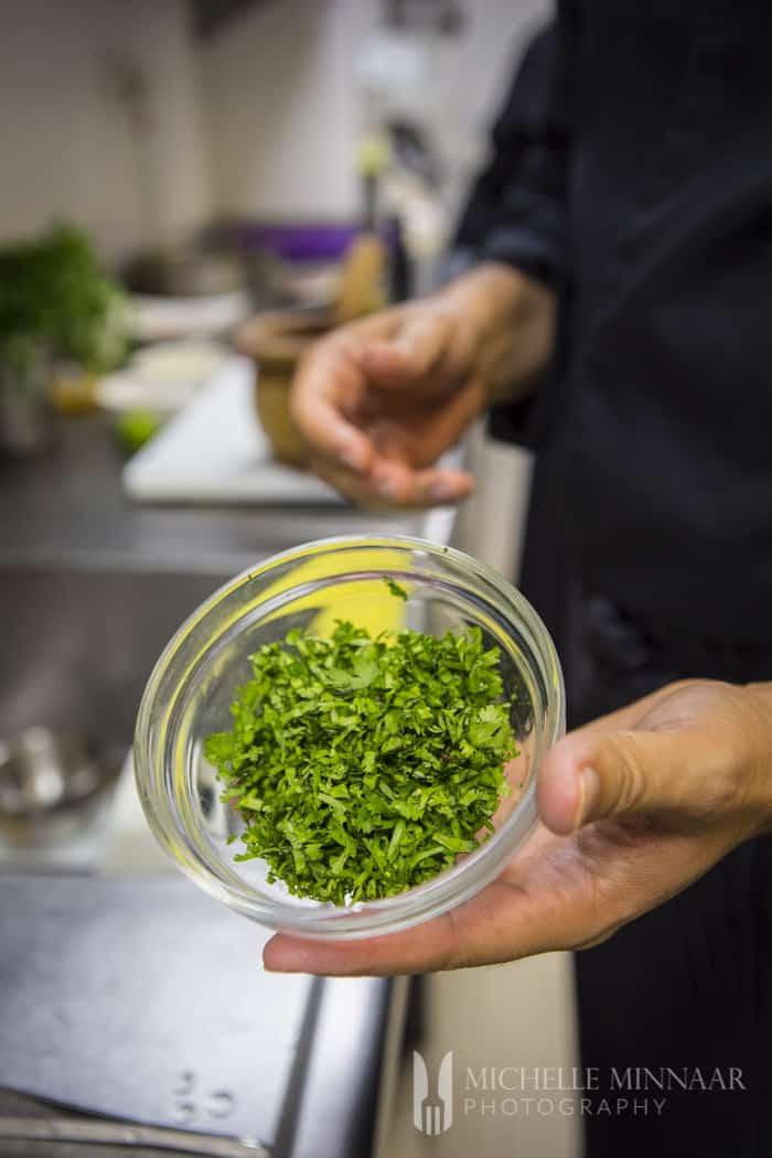 Cilantro in small glass bowl