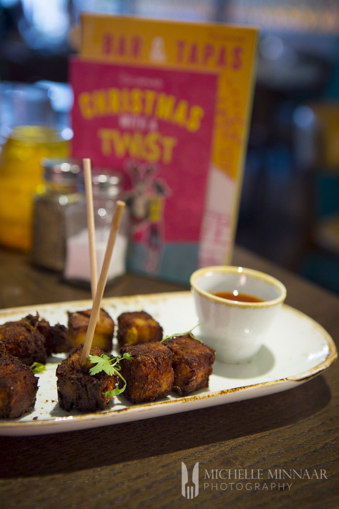 Crispy cheesy cubes served with sticky chilli jam