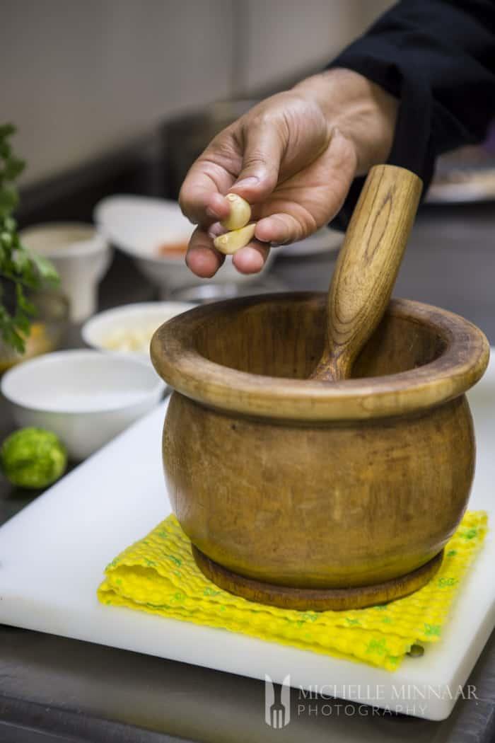 Add garlic to bowl