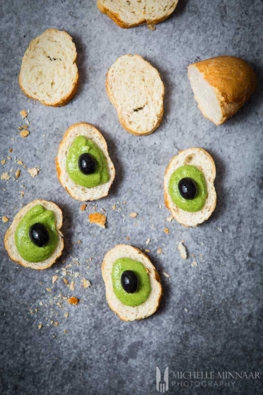 Olive Crostini Avo Pesto