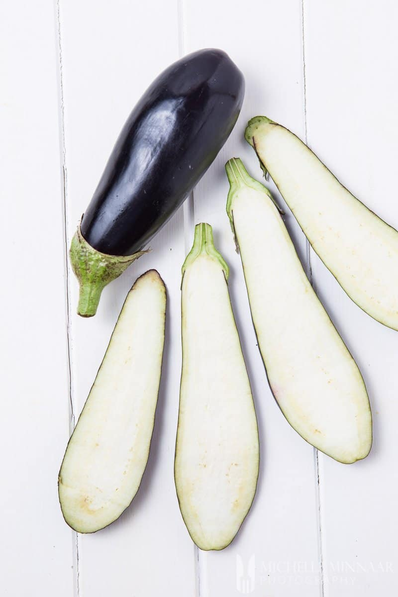 vegan aubergine recipes - A sliced Eggplant