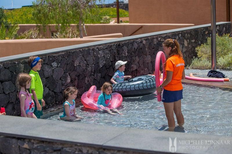 Children playing swimming games