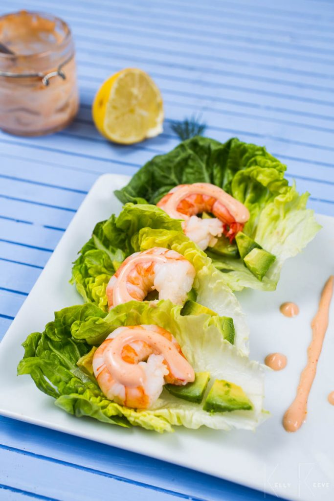 Three large prawns on a bed of lettuce