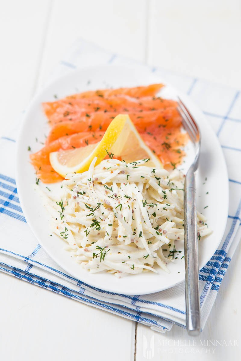 A close up of celeriac remoulade, smoked salmon and a fork