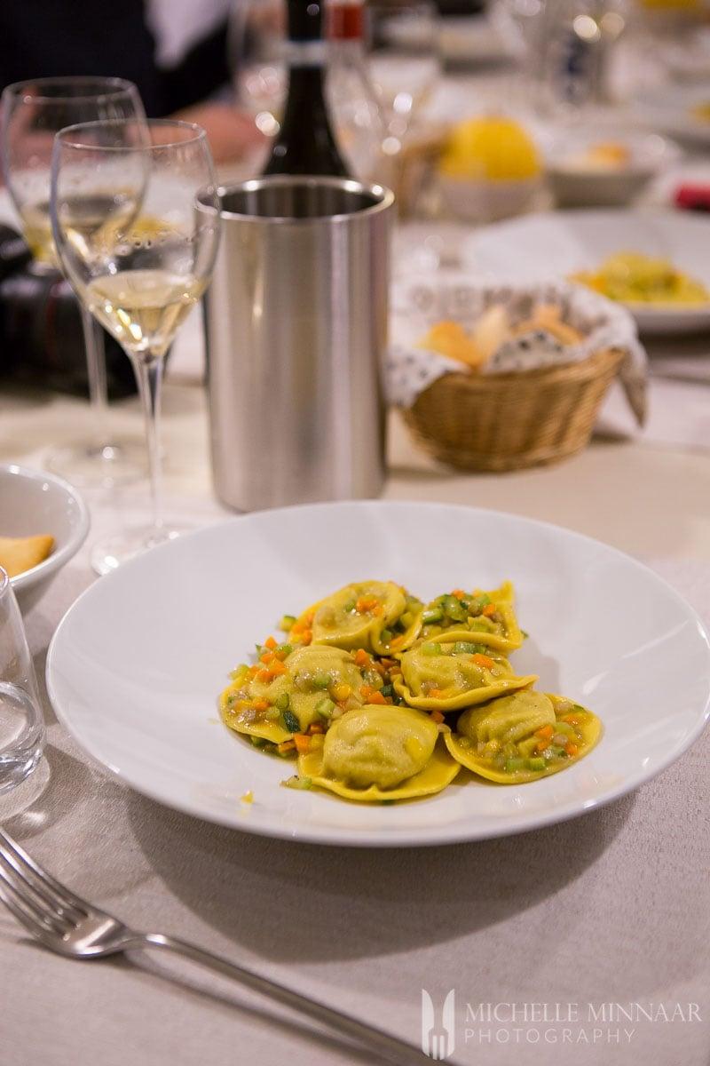 Meat-filled ravioli with vegetables