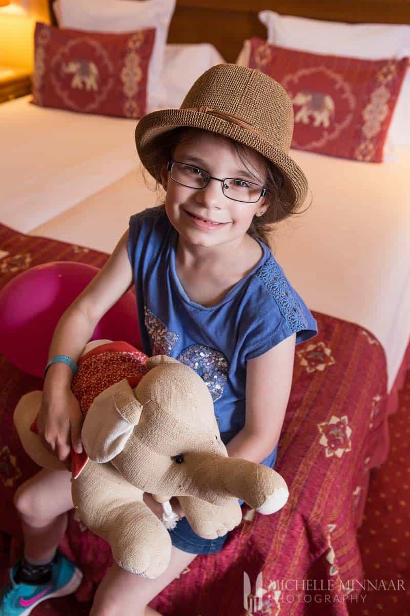 Girl holding elephant soft toy