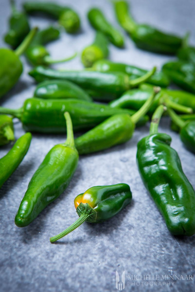 A close up of green peppers