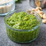 Close up shot of cashew pesto in a clear bowl