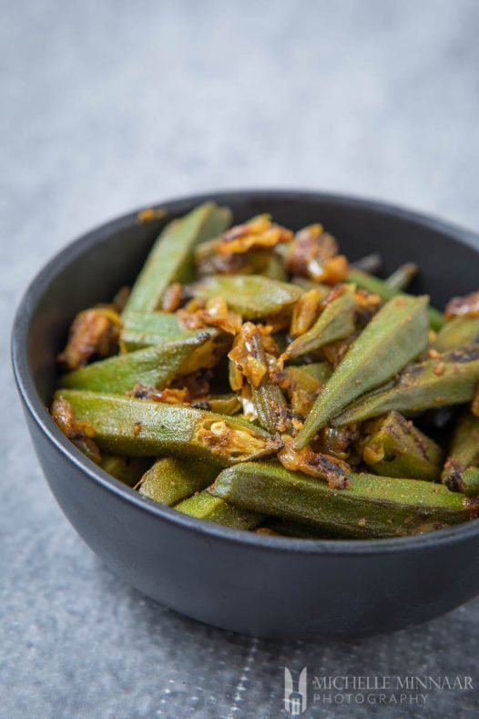 Bhindi ki Sabzi - a bowl of fried green okra upclose