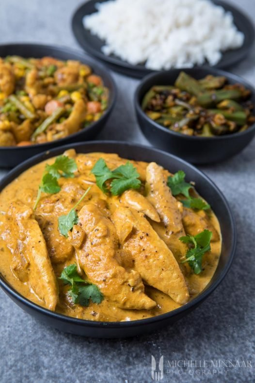 A close up of Korma chicken, orange sauce