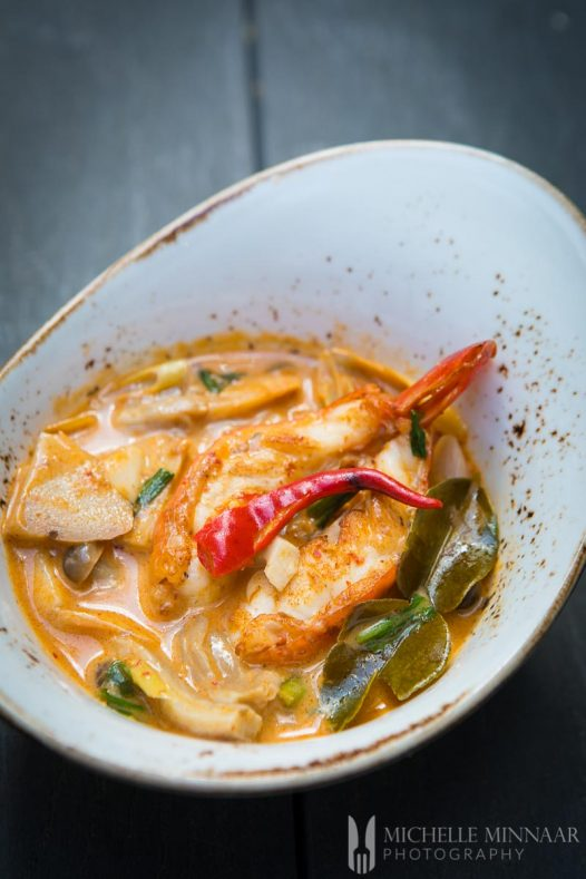 Tom Yum Goong in a white bowl