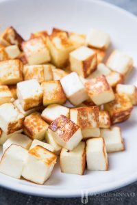 Fried Paneer on a plate, white cubes with brown exterior