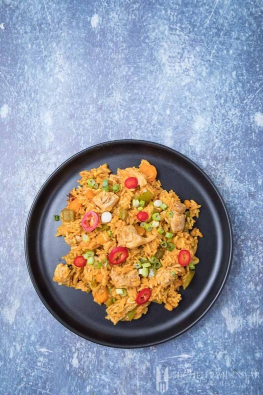 Ghanaian Jollof Rice - an aerial view of rice and chicken