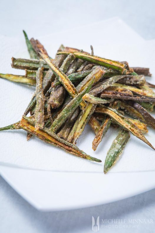 Bhindi Kurkuri - a pile of fried okra on a plate