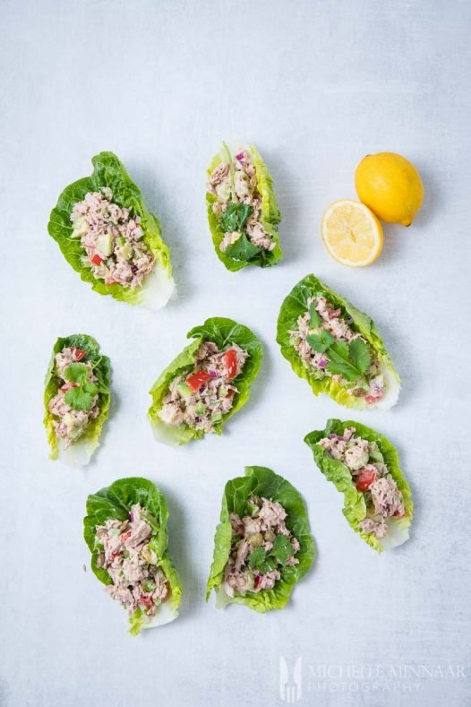 7 Tuna Lettuce Wraps and two lemons on a counter