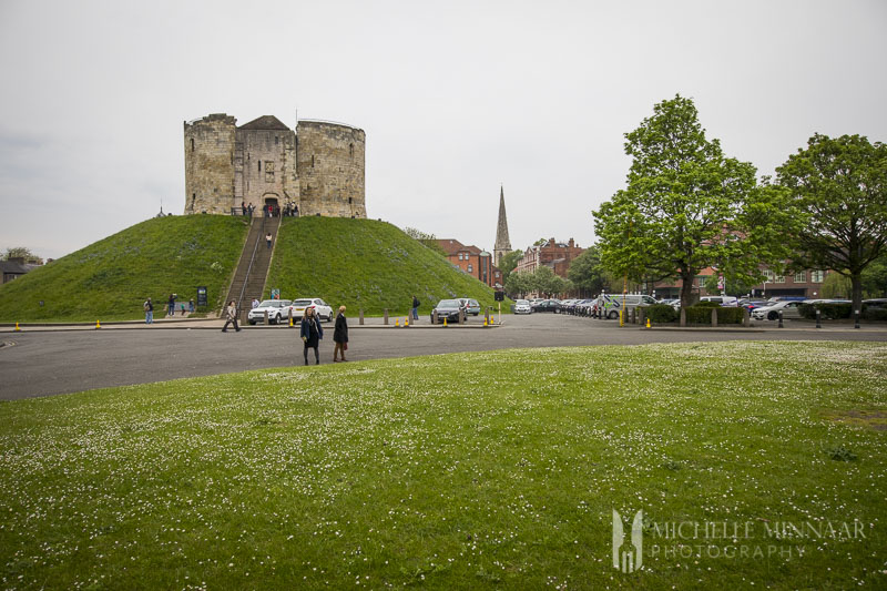 Cliffords tower and green grass