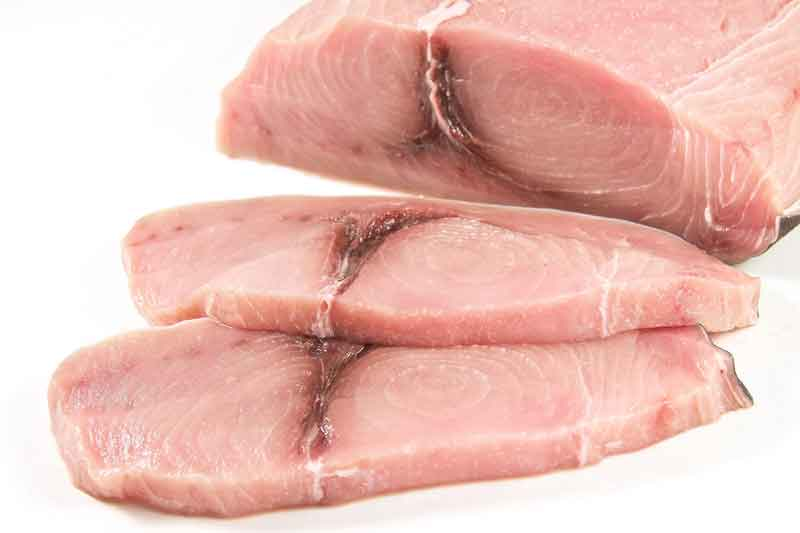 Raw swordfish steaks